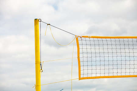 netting: Volleyball summer sport equipment. Closeup of net netting wire on a sandy beach outdoor. Active lifestyle.