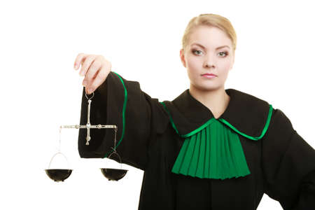 symbol: Law court concept. Woman lawyer attorney wearing classic polish black green gown holds scales. Femida - symbol sign of justice. isolated on white