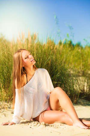 beach babe: Young woman female model posing outdoor on  dunes sky and grass Stock Photo