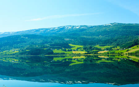 hiils: Tourism vacation and travel. Landscape and fjord in Norway, Scandinavia.  mountain reflections in water.