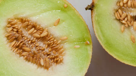 pips: Closeup of melon with pips on table. Fruit, diet and healthy nutrition.