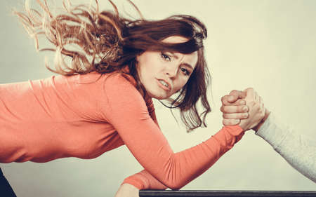 conflict: Partnership relationship concept. Girlfriend confronts his boyfriend. Woman and man arm wrestling challenge between young couple