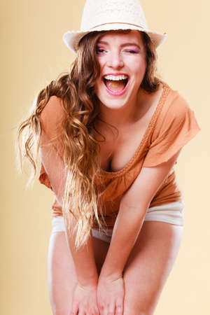 Holidays and summer fashion. Girl in fashionable clothes straw hat laughing. Portrait of charming woman tourist photo