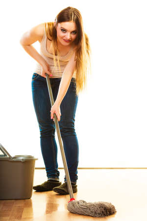 cleanup: Cleanup housework concept. Funny cleaning girl young woman mopping floor, holding mop white background Stock Photo