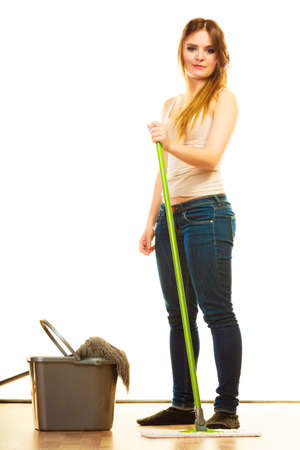 cleanup: Cleanup housework concept. Funny cleaning girl young woman mopping floor, holding two mops new and old white background