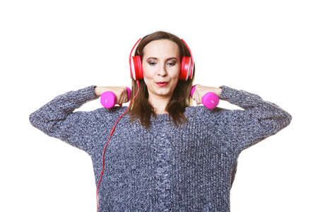 active lifestyle: Active lifestyle, relax concept. Fit woman listening to music while doing exercise with dumbbells