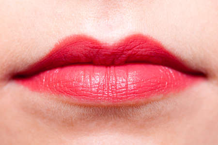 lipgloss: Cosmetic beauty procedures and makeover concept. Closeup part of woman face red lips makeup detail. Lipstick or lipgloss