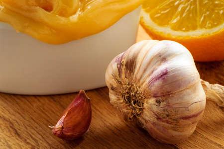 heal sickness: Natural healing, alternative medicine. Healthy ingredients for strengthening immunity. Honey garlic and lemon on wooden rustic table.