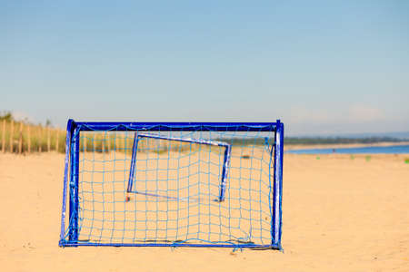 active lifestyle: Summer vacation, active lifestyle concept. Football gate on sandy beach soccer goal Stock Photo