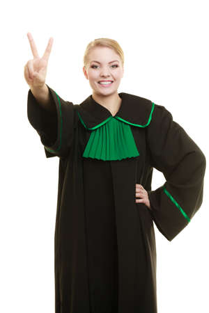 judicature: Law court or justice concept. Young woman lawyer attorney wearing classic polish black green gown making ok sign victory hand gesture isolated on white background Stock Photo