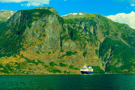 sognefjord: Tourism vacation and travel. Mountains and cruise ship on fjord Sognefjord in Norway, Scandinavia. Stock Photo