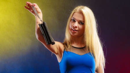dancing club: Fashion elegant evening outfit. Stylish woman fashionable blonde girl holding black rivet leather handbag bag in night club dancing.