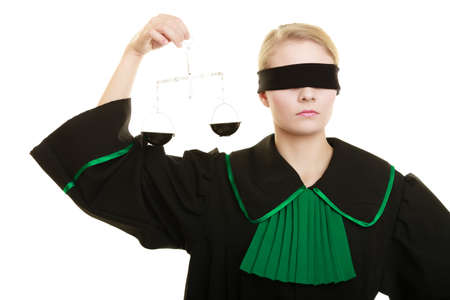 impartial: Law court concept. Woman lawyer wearing classic polish black green gown with covered eyes holds scales. Femida - symbol sign of justice. isolated on white Stock Photo