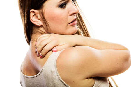 itchy: Health problem. Young woman scratching her itchy back with allergy rash isolated on white Stock Photo