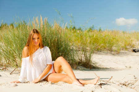 Holidays, vacation travel and freedom concept. Beautiful sexy girl on beach. Young pretty woman relaxing on the sea coast. Stock Photo