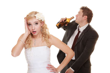 Wedding couple, unhappy bride with alcoholic drinking groom. Woman looking her future make decision - violence alcoholism problems concept photo