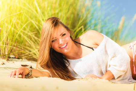 beach babe: Young woman female model posing outdoor on background of dunes sky and grass