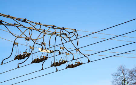 nonpolluting: Trolley overhead line wire switch. Electrical cable. Electricity used in ecological transportation. Stock Photo