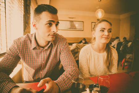 Young couple in a cafe filtered photo photo