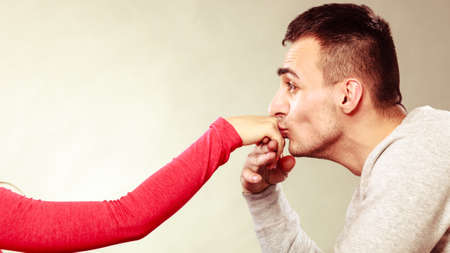 Polite man, husband kissing woman hand palm. Good, happy relationship. Love couple concept.   photo