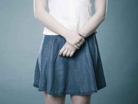 denim skirt: Woman part body. Girl in blue denim skirt standing studio shot Stock Photo