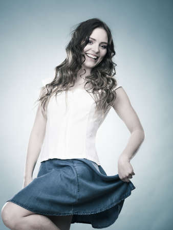 blue hair: Summer holidays and vacation. Lovely girl long curly hair in fashionable casual style clothes on blue