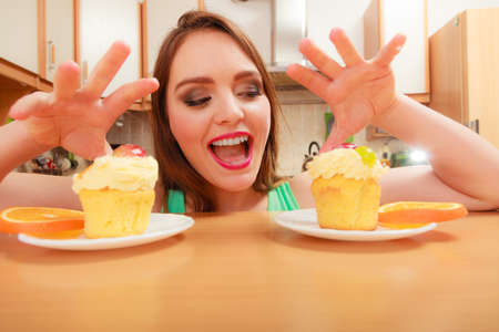gluttony: Woman grabbing delicious cake with sweet cream and fruits on top. Appetite and gluttony concept.
