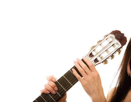 fingerboard: Musical instrument. girl holding acoustic guitar, female hands on fingerboard isolated on white background Stock Photo