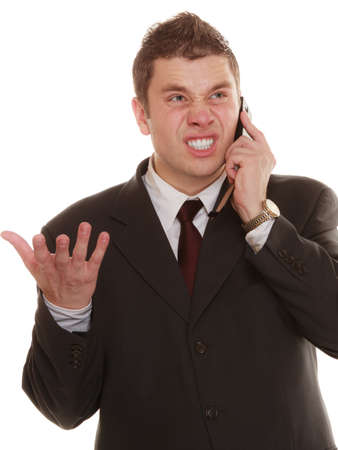 fury: relationship difficulties. Angry man talking on mobile cell phone. Fury businessman screaming, negative facial expression isolated on white.