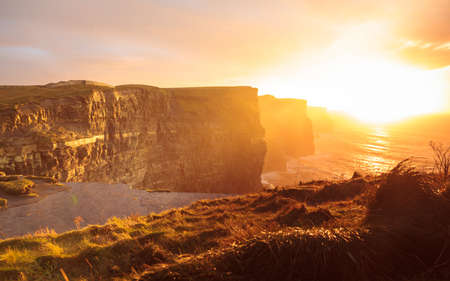 SEA  LANDSCAPE: Famous cliffs of Moher at sunset in Co. Clare Ireland Europe. Beautiful landscape natural attraction.