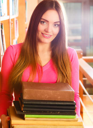 highschool: Education  highschool concept. Lovely female student fashion long hair girl in college library with stack books.
