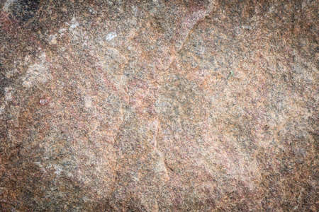 Abstract backdrop. Brown grunge wall stone background or texture pattern solid nature rock photo