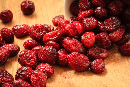 fiber food: Healthy high fiber food organic nutrition. Close up dried cranberries cranberry fruit on wooden table
