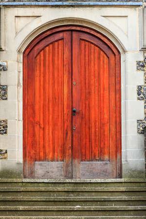 Large double brown orange wood old door in England photo