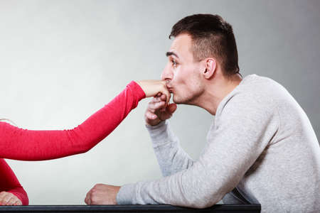politeness: Polite man, husband kissing woman hand palm. Good, happy relationship. Love couple concept.