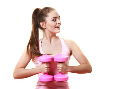 Fitness girl fit woman with dumbbells, doing exercise with dumb bells training with weights isolated on white background photo