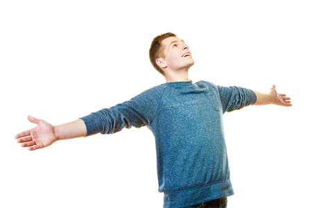 lad: Success positive emotions, happiness freedom. Happy young man successful lad with arms raised looking upwards isolated on white background Stock Photo