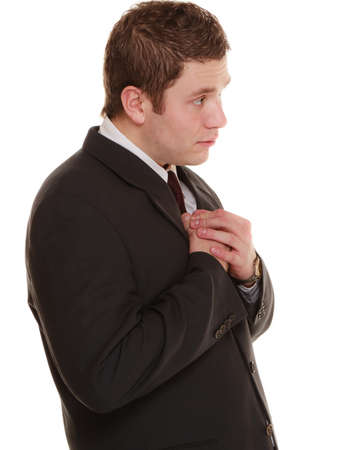 Facial expression body language. Desperate young man showing clasped hands asking forgiveness, praying isolated