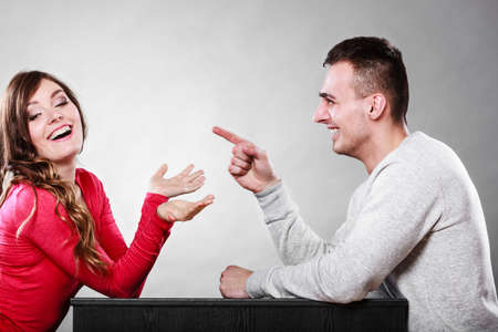 Happy couple talking and laughing on date. Smiling girl and guy having conversation. Amusing man making woman laugh. Good relationship. Foto de archivo