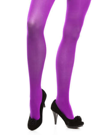 long stockings: Female fashion. Woman with long legs violet color stockings and black high heels isolated on white background Stock Photo