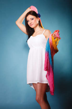 woman fashionable: Summer fashion. Beauty young woman fashionable sensual girl with colored shawl on blue