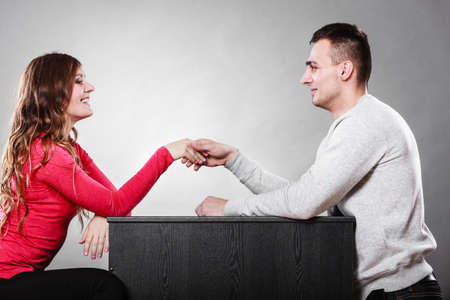 1st: Man and woman first date meeting. Handshake greeting. Male and female shaking hands and getting to know each other.
