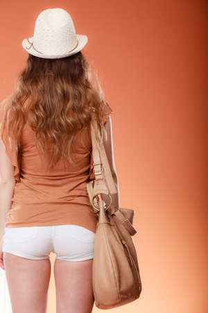 girls back to back: Fashionable woman wearing hat with handbag. Summer fashion. Holidays vacation.