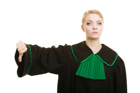 negation: Law court or justice concept. Portrait young woman lawyer attorney wearing polish Poland black green gown making thumb down hand sign on white