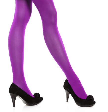 voluptuous women: Female fashion. Woman with long legs and violet stockings and black high heels isolated