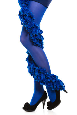 long stockings: Female fashion. Woman long legs blue stockings high heels and warm scarf around leg isolated Stock Photo