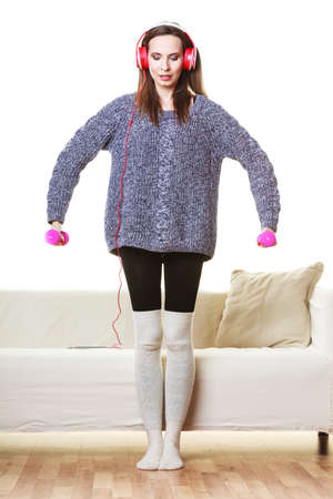 active lifestyle: Active lifestyle, relax concept. Fit woman listening to music while doing exercise with dumbbells at home