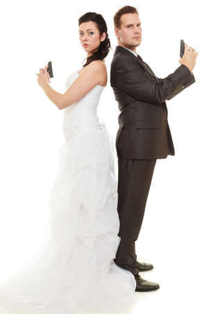 impasse: Bad relationship married couple in conflict. Bride and groom with handgun weapon isolated on white. Man and woman in disagreement. Divorce.