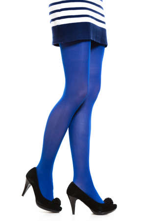 long stockings: Female fashion. Woman with long legs color blue stockings and black high heels isolated on white background
