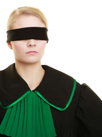 blind justice: Blind justice. Woman lawyer attorney wearing classic polish (Poland) black green gown covering eyes with blindfold isolated on white